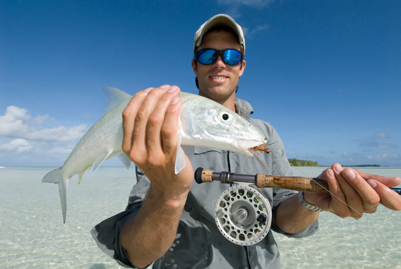 Angler with a Bonefish caught on the Turneffe flats in Belize fishing right at our Belize Dive Haven resort