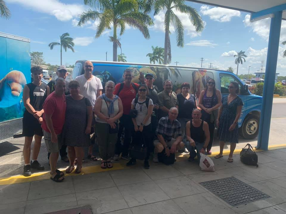 Meeting Guests at the airport with our van and trailer as they prepare for travel to Belize Dive Haven resort.